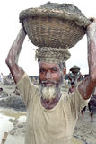 Bengal older man working in gravel pit Stock Images