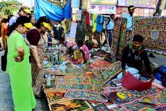 Bengal Patachitra Painting. People are buying folk painting at the fairground of kolkata Royalty Free Stock Photos