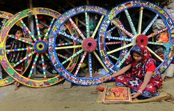 Bengal Patachitra Paintings. A woman artist doing painting Bengal patachitra in a small tribal art village in West Bengal-India, where a few families having a Royalty Free Stock Image