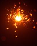 Bengala de la Navidad con la luz roja Fotografía de archivo libre de regalías
