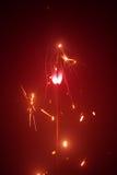 Bengala de la Navidad en neblina con la luz roja Foto de archivo