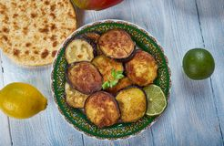 Bengali Beguni. Beguni, made of eggplant which is sliced and battered , Bengali cuisine, Asia Traditional assorted dishes, Top view royalty free stock image