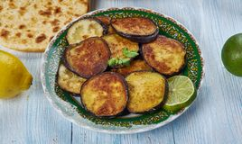 Bengali Beguni. Beguni, made of eggplant which is sliced and battered , Bengali cuisine, Asia Traditional assorted dishes, Top view stock photos