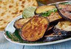 Bengali Beguni. Beguni, made of eggplant which is sliced and battered , Bengali cuisine, Asia Traditional assorted dishes, Top view royalty free stock photography