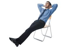 Bengali businessman reclining on a chair Stock Photo