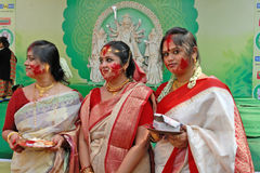 Bengali Community In Kolkata. Married Bengali Hindu women smear and play with vermilion during Sindur Khela traditional ceremony on the final day of Durga Puja Stock Images