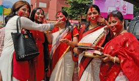 Bengali Community In Kolkata. Married Bengali Hindu women smear and play with vermilion during Sindur Khela traditional ceremony on the final day of Durga Puja Royalty Free Stock Photography