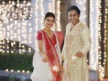 Free Bengali Couple Burning Firecrackers Royalty Free Stock Images - 36256379