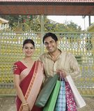 Bengali couple carrying shopping bags Royalty Free Stock Photo