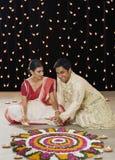 Bengali couple lighting oil lamps Stock Photos