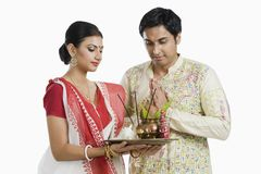 Bengali couple praying. Together on Diwali stock images