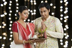 Bengali couple praying. Together on a festival royalty free stock photography