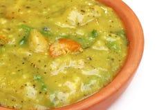 Bengali cuisine – Mashkalai dal with shrimp. On a clay pottery Stock Image