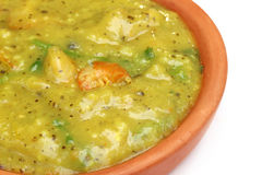Bengali cuisine – Mashkalai dal with shrimp. On a clay pottery stock image