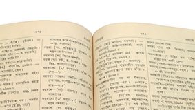 Bengali dictionary. Old open Bengali dictionary book stock image