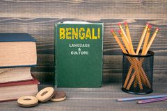 Bengali language and culture concept. Book on a wooden background royalty free stock photo