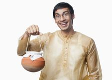Bengali man carrying a pot of rasgulla Royalty Free Stock Images
