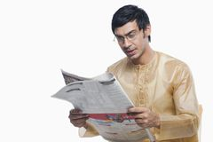 Bengali man reading a newspaper Stock Images