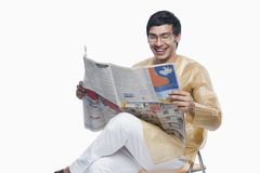 Bengali man reading a newspaper Stock Photography