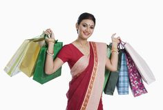 Bengali woman carrying shopping bags. Portrait of a Bengali women carrying shopping bags royalty free stock photos
