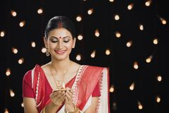 Bengali woman holding an oil lamp Royalty Free Stock Photo