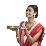 Bengali woman holding pooja thali. Traditional Bengali woman holding pooja thali Royalty Free Stock Photos