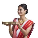 Bengali woman holding pooja thali Stock Photo