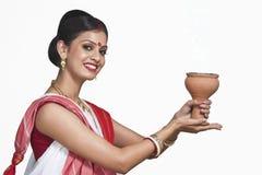 Bengali woman praying Royalty Free Stock Image