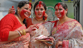 Bengali Women. Married Bengali Hindu women smear and play with vermilion during Sindur Khela traditional ceremony on the final day of Durga Puja festival on Stock Photos
