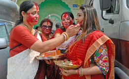 Bengali Women. Married Bengali Hindu women smear and play with vermilion during Sindur Khela traditional ceremony on the final day of Durga Puja festival on Stock Photo