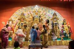 Bengali women worshipping Goddess Durga at Puja pandal, Kolkata, West Bengal, India. KOLKATA , INDIA - OCTOBER 18, 2015 : Married Bengali women worshipping Stock Image