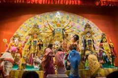 Bengali women worshipping Goddess Durga at Puja pandal, Kolkata, West Bengal, India. KOLKATA , INDIA - OCTOBER 18, 2015 : Married Bengali women worshipping Stock Photos