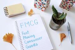 Beni di consumo rapidi di FMCG scritti in taccuino fotografia stock