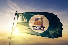 Beni Suef Governorate of Egypt flag textile cloth fabric waving on the top sunrise mist fog. Beautiful royalty free stock images