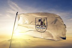 Beni Suef Governorate of Egypt flag textile cloth fabric waving on the top sunrise mist fog. Beautiful stock image