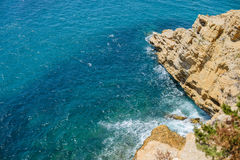 Benidorm beach in summer day. View of the beach in Benidorm with rocks Royalty Free Stock Photos