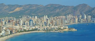 Benidorm Poniente and Levante Beaches. A view of Benidorms´Poniente Beach on the left and Levante Beach on the right with Benidorm Town and Mountains as the Royalty Free Stock Photography