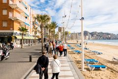 BENIDORM, SPAIN, December 14, 2017: People walking on the embankment of Benidorm, Spain. BENIDORM, SPAIN, December 14, 2017: People walking on the embankment of Royalty Free Stock Photos