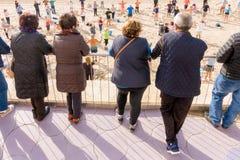 Benidorm, Spain, January 29, 2018: Elderly people watch how active seniors are doing sports exercises on the beach in. Benidorm, Alicate, Spain stock photos