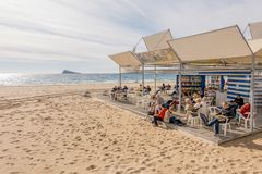 Benidorm, Spain - January 14, 2018: People resting, reading and playing chess resting in public Benidorm Levante Beach royalty free stock images