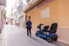 Benidorm, Spain - January 29, 2018: Tourist like to use hired mobility scooters in the street of Benidorm, Spain.  stock images