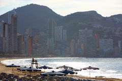 Benidorm sunrise with hammocks and parasol Royalty Free Stock Photography