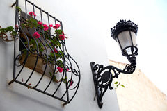 Benidorm white facade window with flowers pot Royalty Free Stock Photos