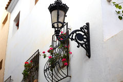 Benidorm white facade window with flowers pot Royalty Free Stock Photography