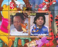 Disney Caharacter and Olympic Rings. BENIN - CIRCA 2007: stamp printed by Benin, shows Diego Maradona, Disney Caharacter and Olympic Rings, circa 2007 Stock Images