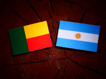 Benin flag with Argentinian flag on a tree stump isolated Royalty Free Stock Image