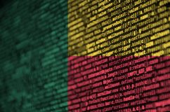Benin flag is depicted on the screen with the program code. The concept of modern technology and site development.  royalty free stock photos