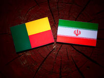 Benin flag with Iranian flag on a tree stump isolated. Benin flag with Iranian flag on a tree stump Royalty Free Stock Photography