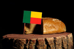 Benin flag on a stump with bread. Isolated royalty free stock photography