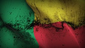 Benin grunge dirty flag waving on wind. Beninese background fullscreen grease flag blowing on wind. Realistic filth fabric texture on windy day Royalty Free Stock Image